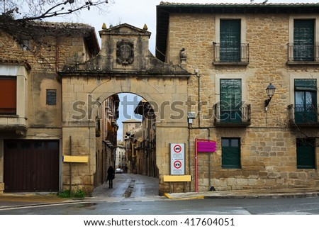 arch at street of old   town in Navarre. Olite, Spain - stock photo