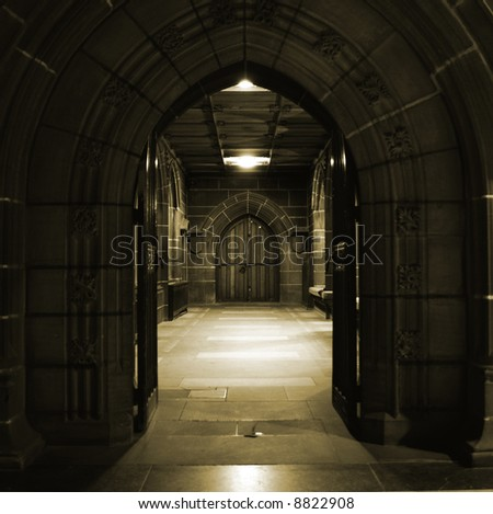 Arched doors in ancient building - stock photo