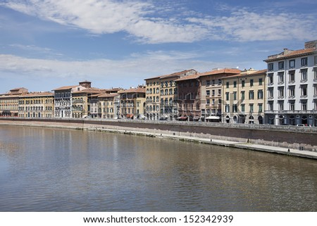 Arno River and waterfront buildings, Pisa. Tuscany, Italy