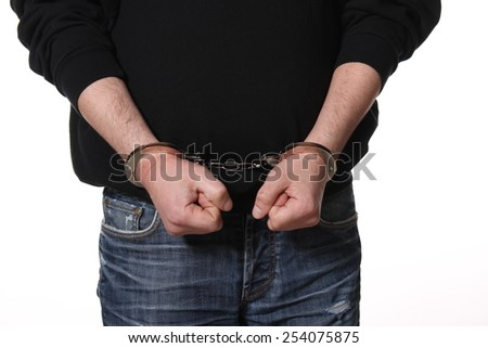 Arrested man handcuffed hands - stock photo