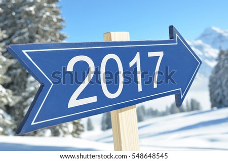 2017 arrow against snowy mountains