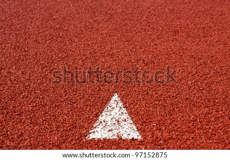 arrow sign on running track rubber cover texture for background - stock photo