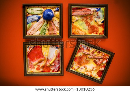 art picture frames on red wall - stock photo