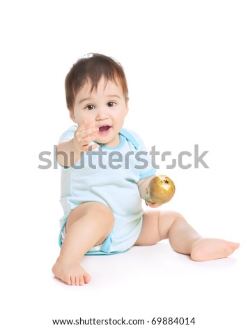 asian baby boy  with pear on a white background