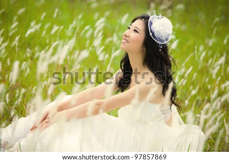 asian bride in her wedding dress - stock photo