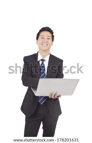 Asian Businessman Holding Laptop Computer