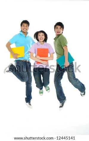 3 Asian happy students jumping the air isolated over a white background - stock photo