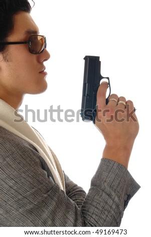 asian man holding gun in hand - stock photo