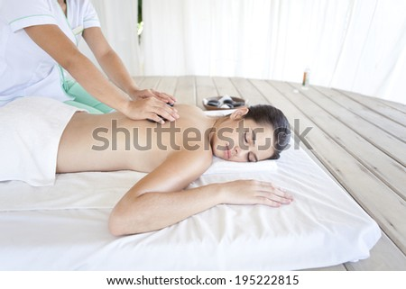 Asian woman having massage treatment in Boracay in the Philippines