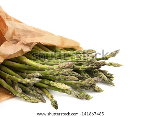 Asparagus in a paper bag, isolated. - stock photo