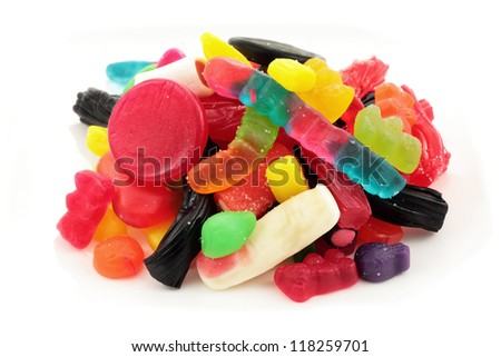assorted selection of gummy candy or jelly in a variety of colors shapes and flavors isolated - stock photo