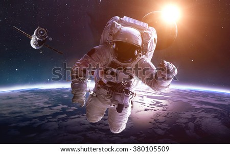 Astronaut in space over the planet Earth. Elements of this image furnished by NASA - stock photo