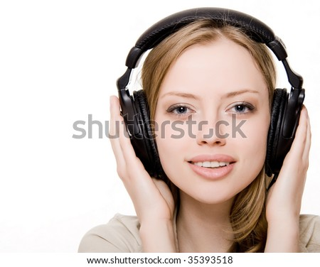 at attractive girl with headphones - stock photo