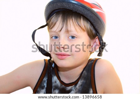 At the head of a boy wearing a protective bicycle helmet. Isolated on a white background. - stock photo