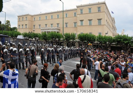 ATHENS, GREECE -JUNE 15. Protesters in front of Greek Parliament. during demonstration , in Athens, June 15, 2011. - stock photo