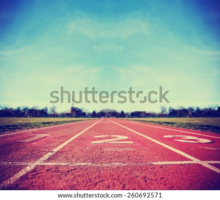 Athlete Track or Running Track with three numbers (1st, 2nd and 3rd) good for business or motivation designs toned with a retro vintage instagram filter app or action effect  - stock photo