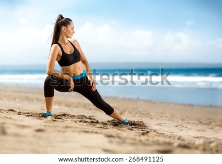 Athletic fitness woman doing workout on beach - stock photo