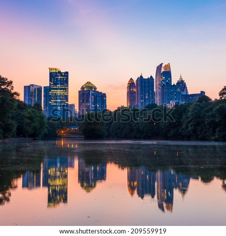 Atlanta, Georgia Skyline from Piedmont Park's Lake Meer. - stock photo