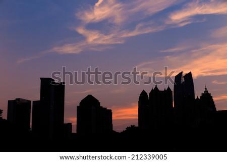 Atlanta, Georgia Skyline from Piedmont Park's Lake Meer. - stock photo