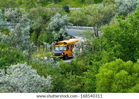 """ATTN REVIEWER: See an Admin about this batch (re:case #00652640) school bus on highway off-ramp in summertime - stock photo"