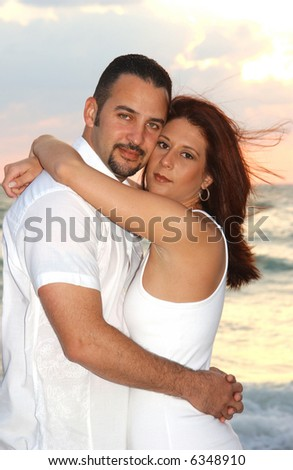 Attractive Brunette Man and Woman at the Beach