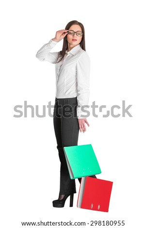 attractive businesswoman in glasses dropped red and green folders isolated on white background   - stock photo