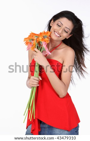 attractive teenage girl with orange  daisy flowers