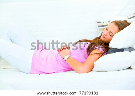 Attractive woman sleeping on couch at living room - stock photo