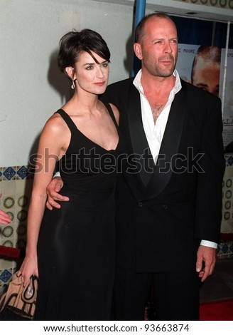 """06AUG97:  Actress DEMI MOORE & husband BRUCE WILLIS at the premiere, in Los Angeles, of her new movie, """"G.I. Jane."""" - stock photo"""