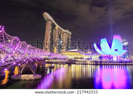 Aug 2014:Front view of the Marina Bay Sands Resort at the mouth of the Singapore River August 15, 2014 in Singapore. This waterfront resort and casino is a tourist attraction. - stock photo