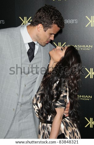 17 August 2011 - Hollywood, California - Kris Humphries, Kim Kardashian. Kardashian Kollection Launch Party held at The Colony. Photo Credit: Russ Elliot/AdMedia - stock photo