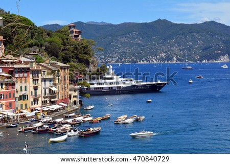 6 August 2016. Photography of the beautiful Portofino fishing village in Italy. View on small bay and colorful houses at town of Portofino in Liguria, Italy.