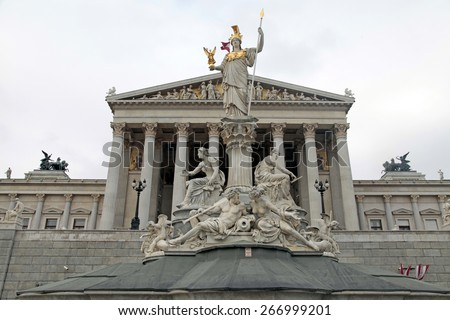 Austrian Parliament and Athena monument, Vienna, Austria. Austrian Parliament building is one of the most popular tourist attractions in Vienna - stock photo