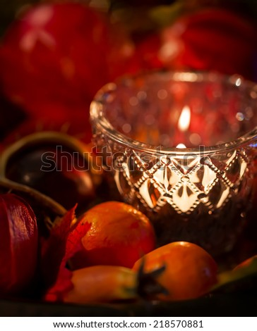 Autumnal decoration with candlelight - stock photo