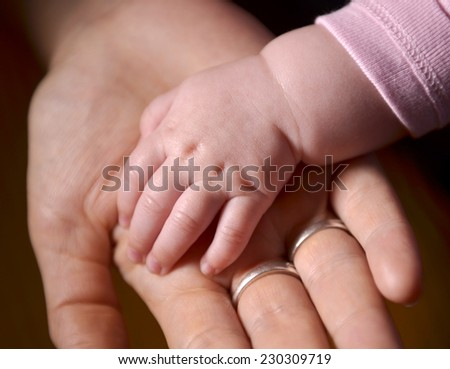 Baby and mother hands - stock photo