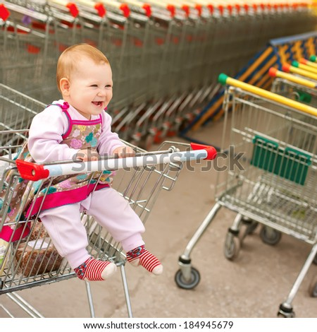 baby in shopping cart - trolley