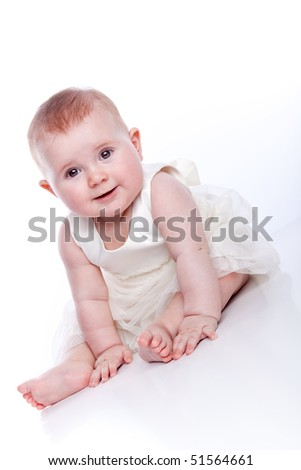 Baby princess. Very cute happy baby girl wearing princess dress. Isolated on white.