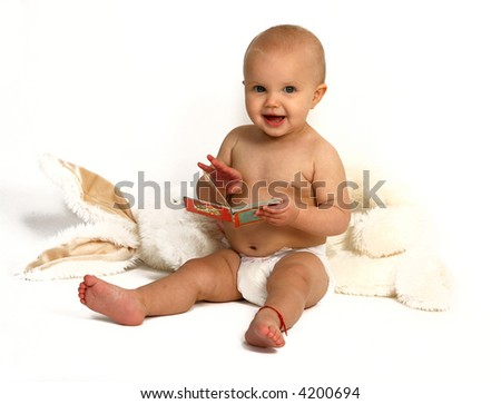 Baby reading the book - stock photo