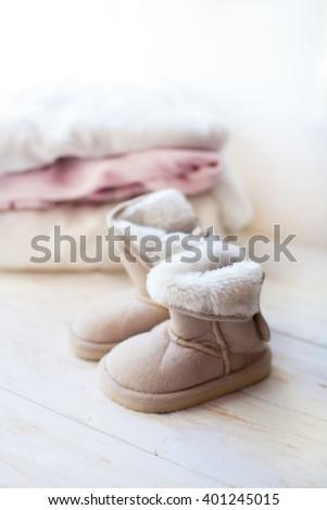 baby  ugg on white background - stock photo