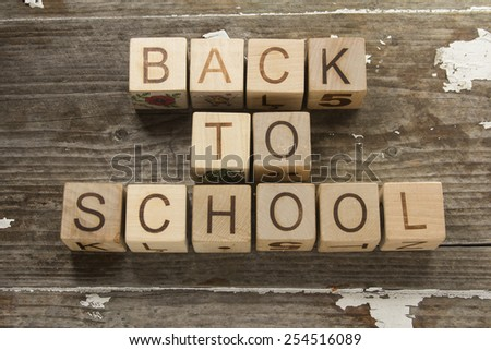"""""""Back to School"""" text on a wooden background - stock photo"""