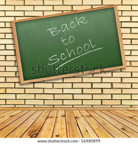"""""""Back to school!"""" theme in interior with brick wall and wooden floor - stock photo"""