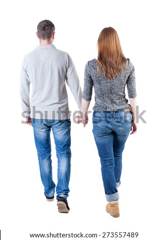 Back view going couple. walking friendly girl and guy holding hands. Rear view people collection. backside view of person. Isolated over white background. Holding hands couple went off.  - stock photo