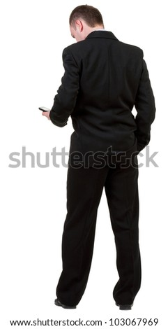 back view of business man in black suit  talking on mobile phone.    rear view people collection. Isolated over white background. backside view of person. - stock photo