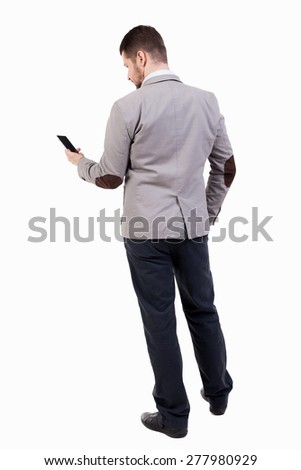 back view of business man in suit  talking on mobile phone.    rear view people collection. Isolated over white background. backside view of person. Businessman reading sms on the phone. - stock photo