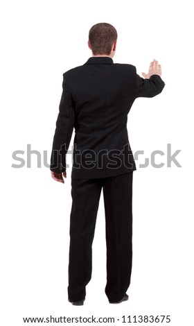 back view of Businessman . Young guy in black suit  watching. Isolated over white background. Rear view people collection. backside view of person. - stock photo
