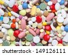 Background from colored pills, tablets and capsules - stock photo