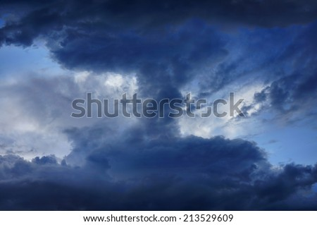 Background of dark clouds before a thunder storm       - stock photo