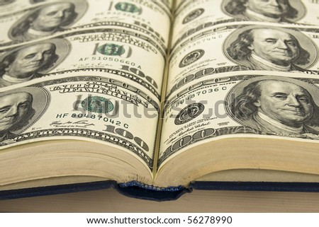 Background of Money in book. book with pages of dollars \ Dollars in  books - stock photo