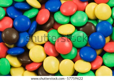 background of multicolored candy coated chocolate sweets - stock photo