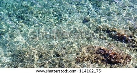 2:1 background of sea water with stones on the bottom - stock photo